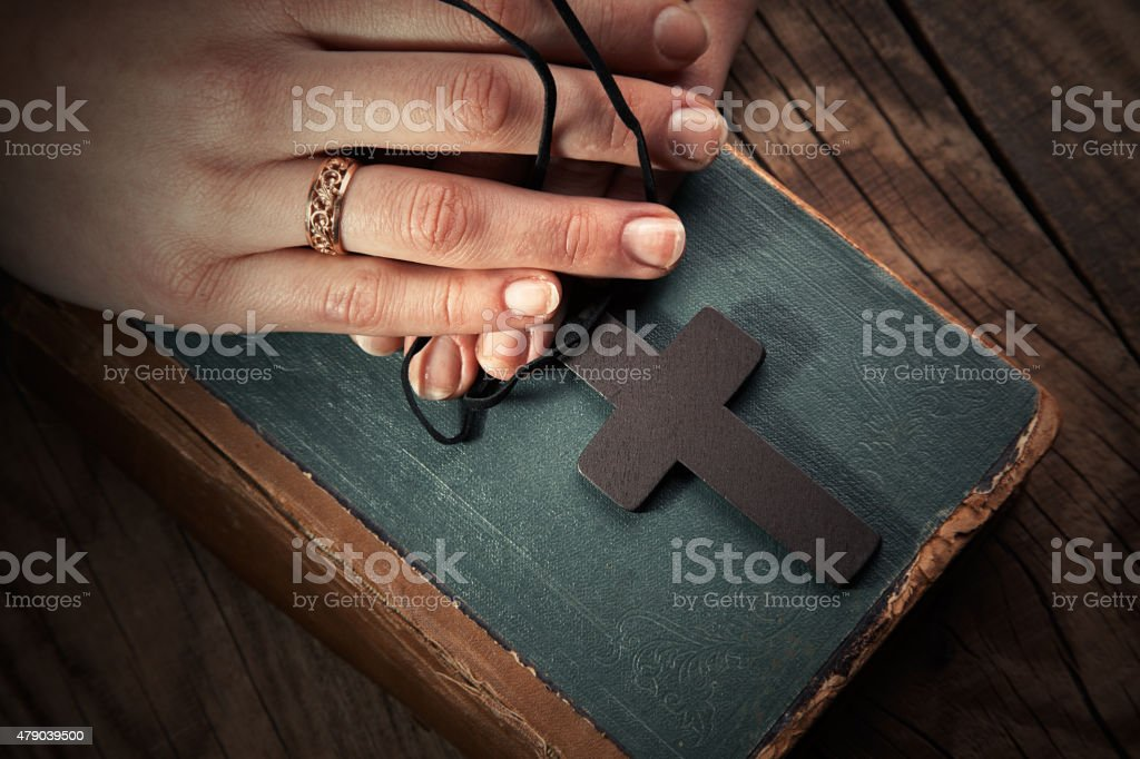 9153fc2df Adult, Bible, People, Praying, Religious Text. closeup of hands holding  vintage cross on Bible royalty-free stock photo