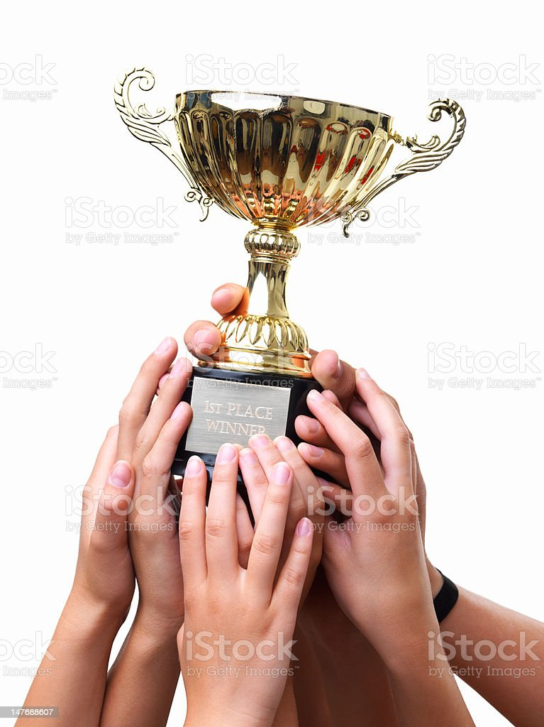 Close-up of hands holding winning cup against white background stock photo