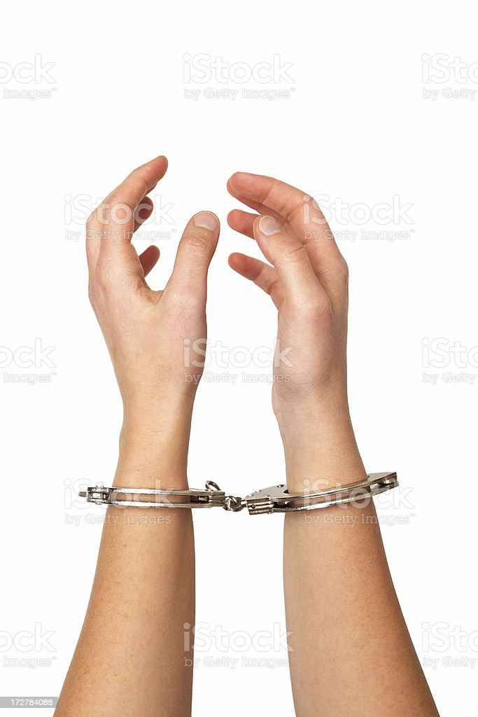 Close-up of hands in handcuffs royalty-free stock photo