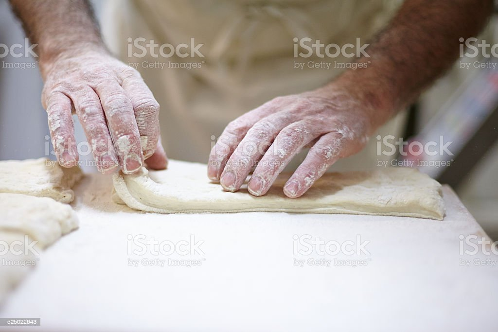 closeup of hands kneading bread stock photo