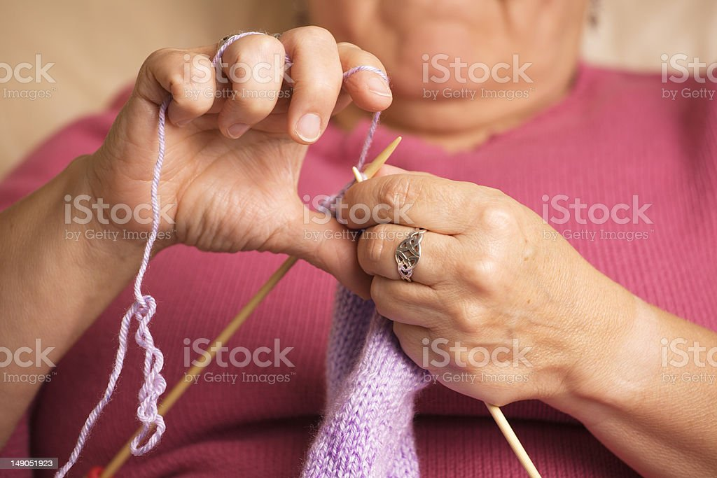 Closeup of hands knitting royalty-free stock photo
