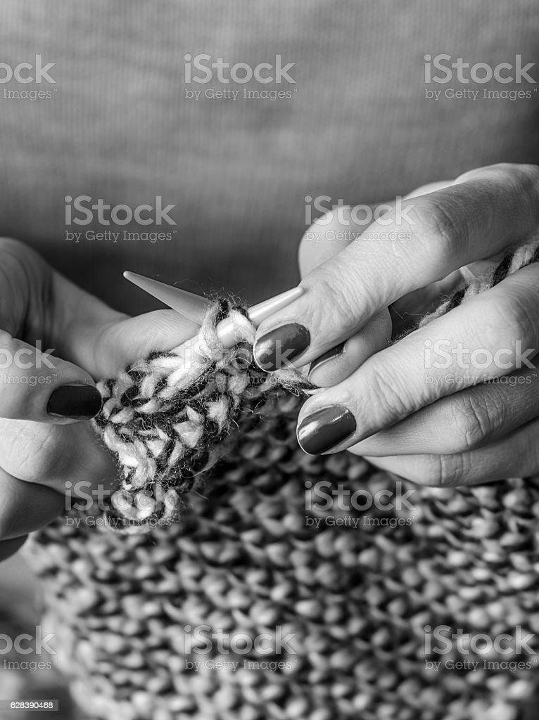 Close-up of hands knitting stock photo
