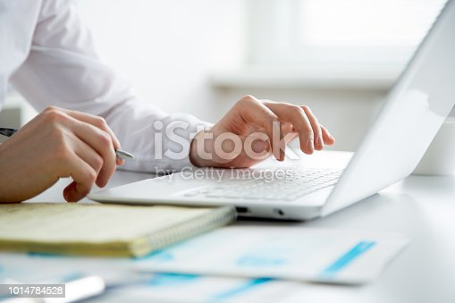 879813798 istock photo Close-up of hands of business man typing on a laptop. 1014784528