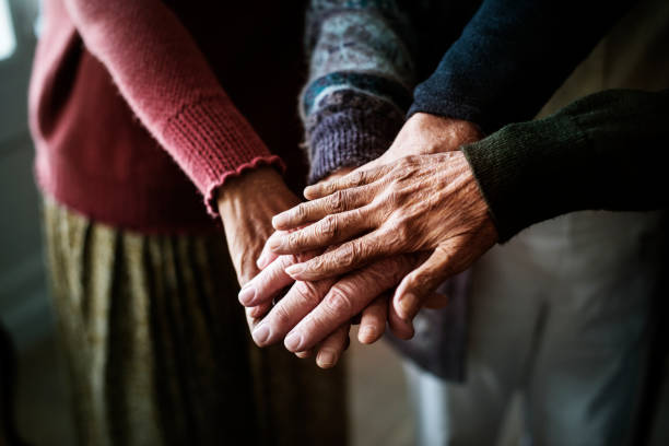 Closeup of hands of group of seniors Closeup of hands of group of seniors retirement community stock pictures, royalty-free photos & images