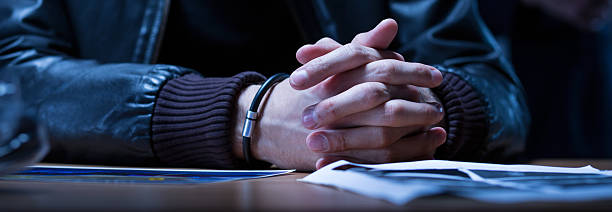 Close-up of hands of suspect Close-up of the hands of a young man suspected police interview stock pictures, royalty-free photos & images