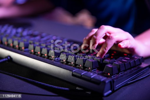 Young professional esports players playing games