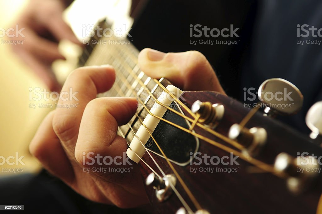 Closeup Of Hands Playing Guitar Chords On Frets Stock Photo More