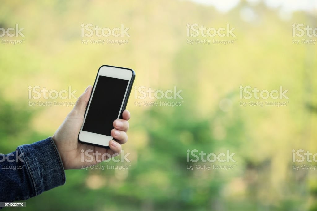 closeup of hands using smartphone taking photo outdoor royalty-free stock photo