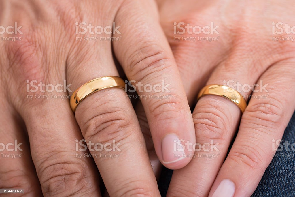 Close-up Of Hands With Rings stock photo