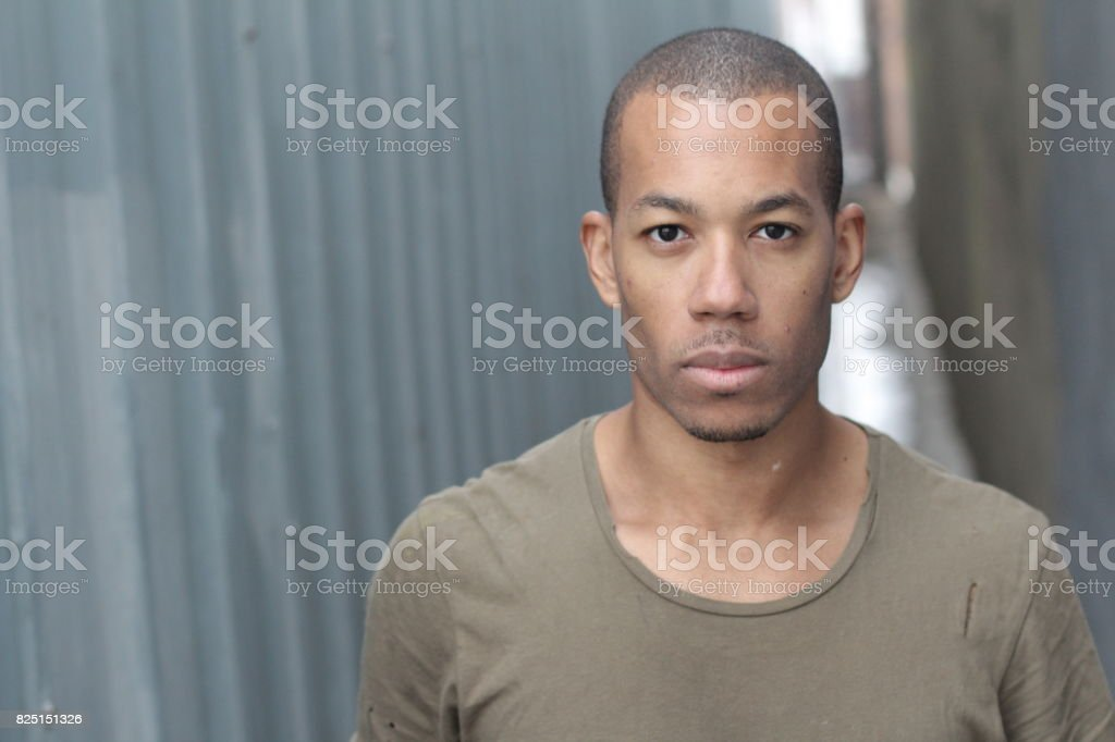 Close-up of handsome young dark-skinned man stock photo