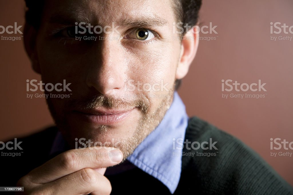 Closeup of Handsome Young Man with Half Face Darkened royalty-free stock photo