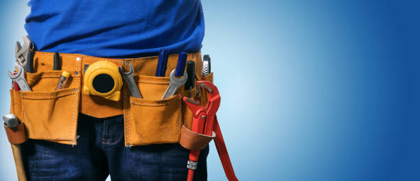 closeup of handyman tool belt on blue background with copy space closeup of handyman tool belt on blue background with copy space repairman stock pictures, royalty-free photos & images