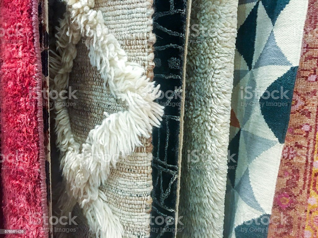 Close-up of hanging area rugs stock photo