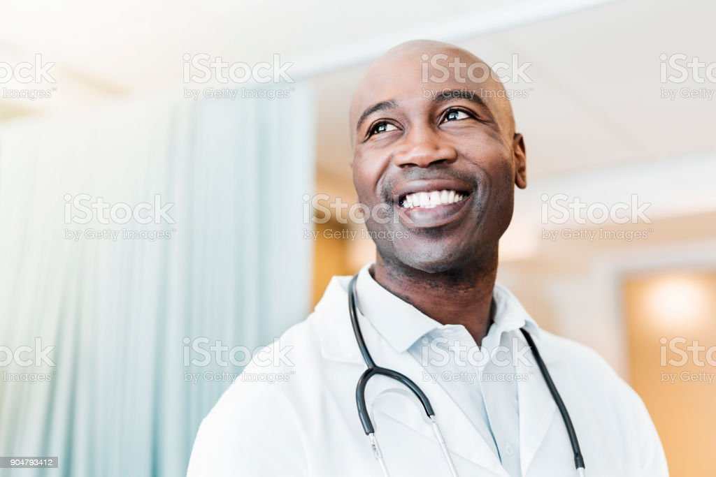 Close-up of happy confident doctor looking away stock photo