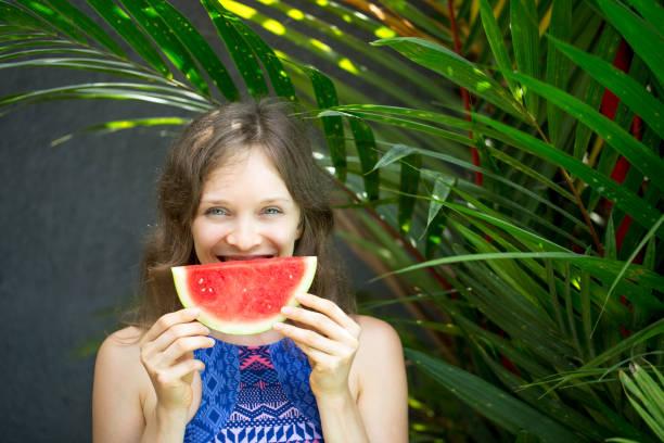 Closeup of Happy Nice Woman Eating Watermelon stock photo