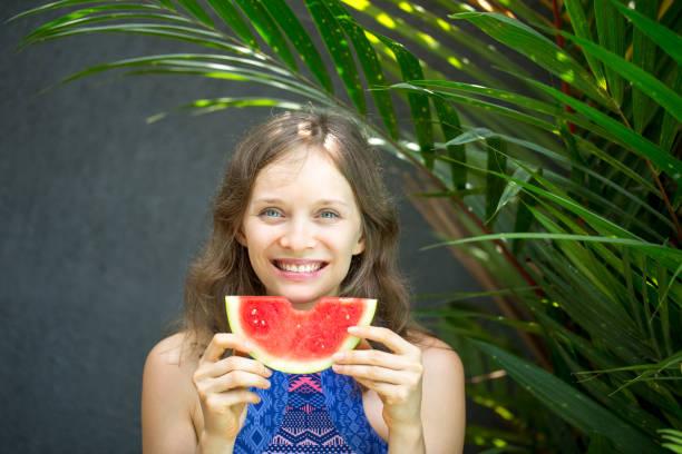 Closeup of Happy Nice Woman With Bitten Watermelon stock photo