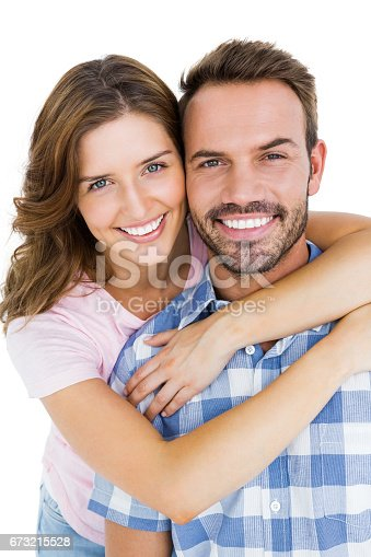 673176670 istock photo Close-up of happy young couple embracing 673215528