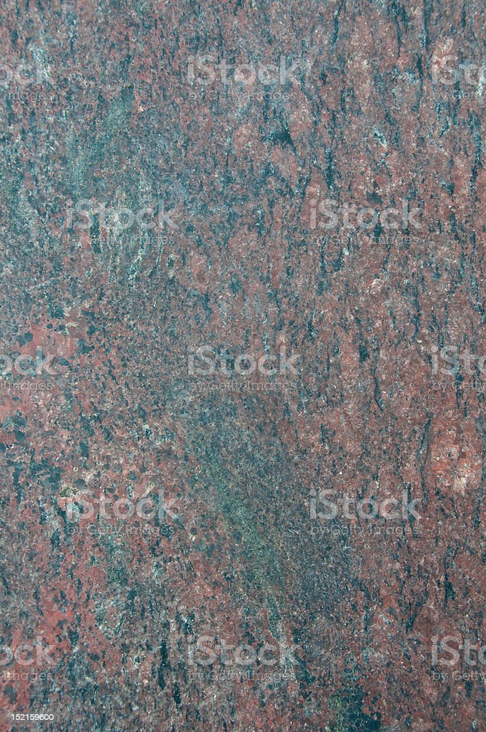 Close-up of hard red and blue granite floor tile abstract stock photo