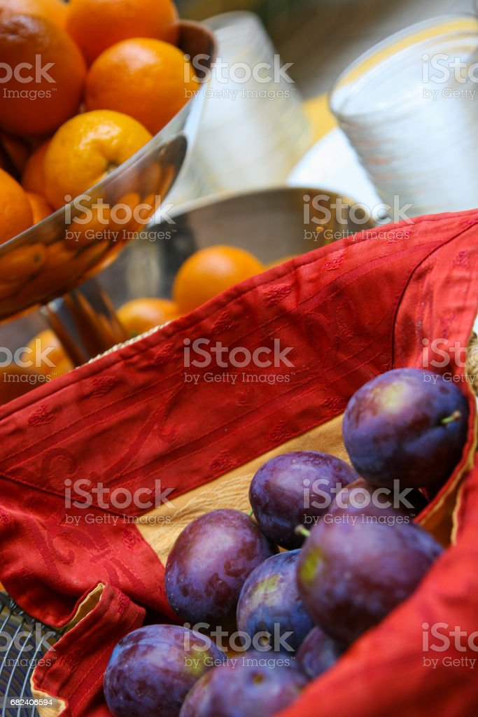 Close-up of healthy food, tangerines and purple plums. royalty-free stock photo