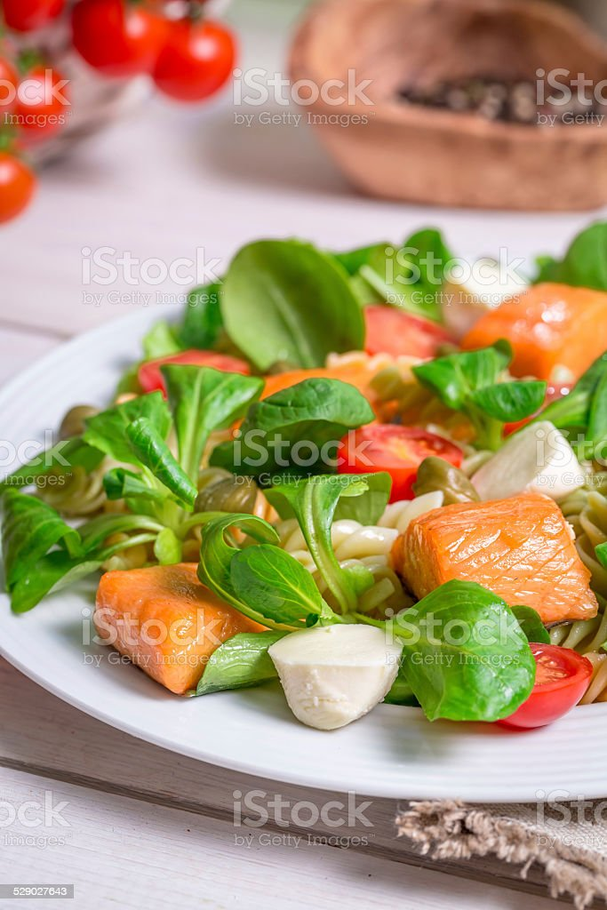 Closeup of healthy salad with salmon stock photo