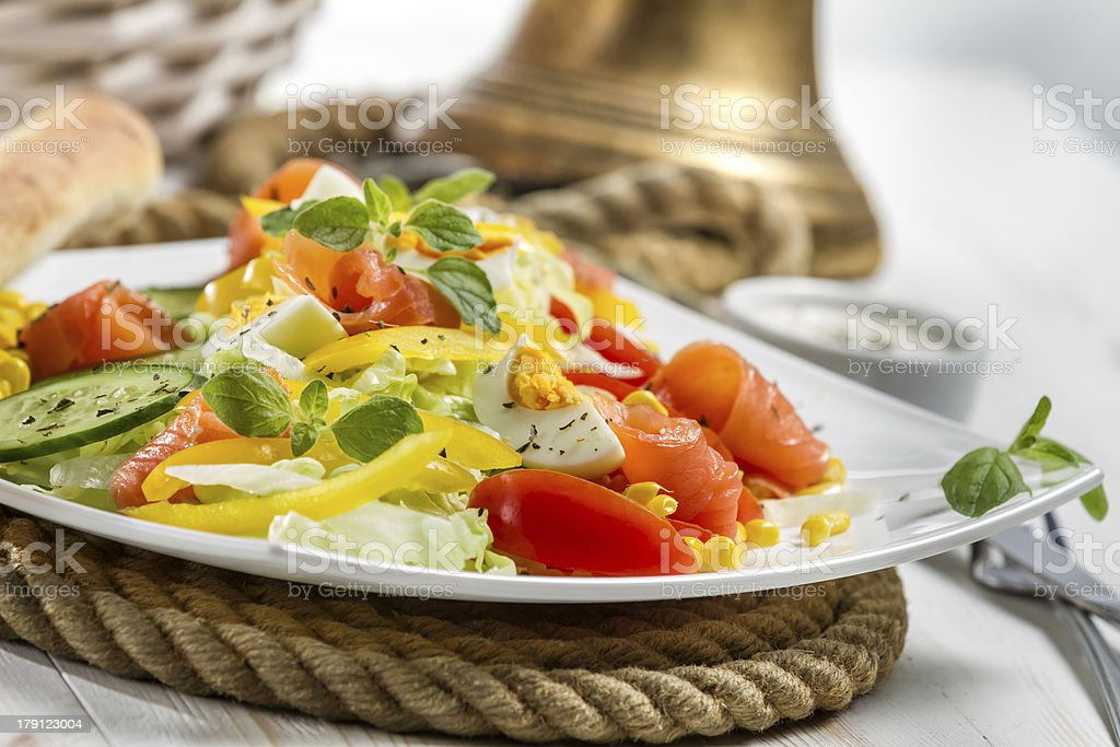 Closeup of healthy salmon and fresh vegetables royalty-free stock photo