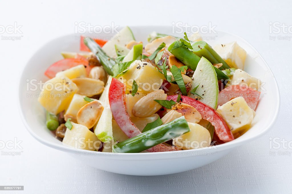 Closeup of healthy vegetable salad on white background stock photo