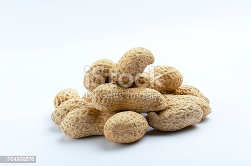 Top view of blue background and raws of peanuts on it