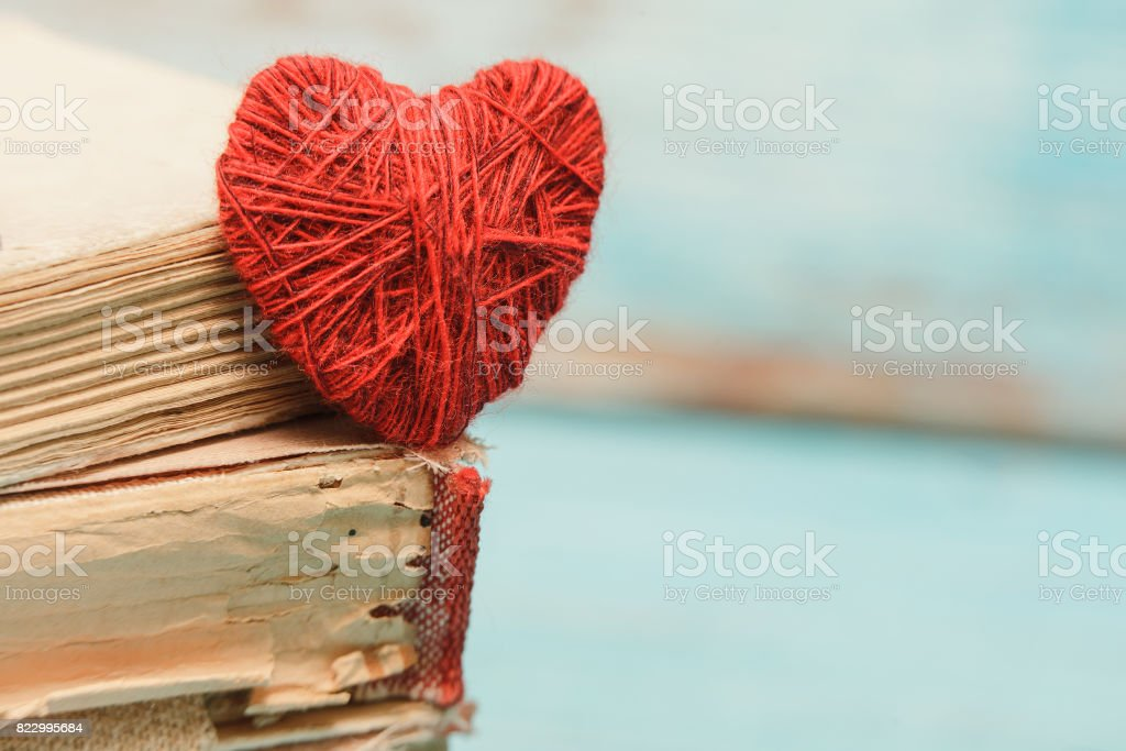 Closeup Of Heart And A Book On The Old Wooden Turquoise