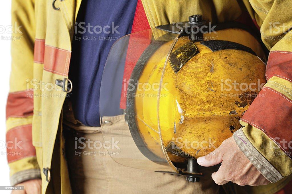 Closeup of Helmet Held By Firefighter stock photo