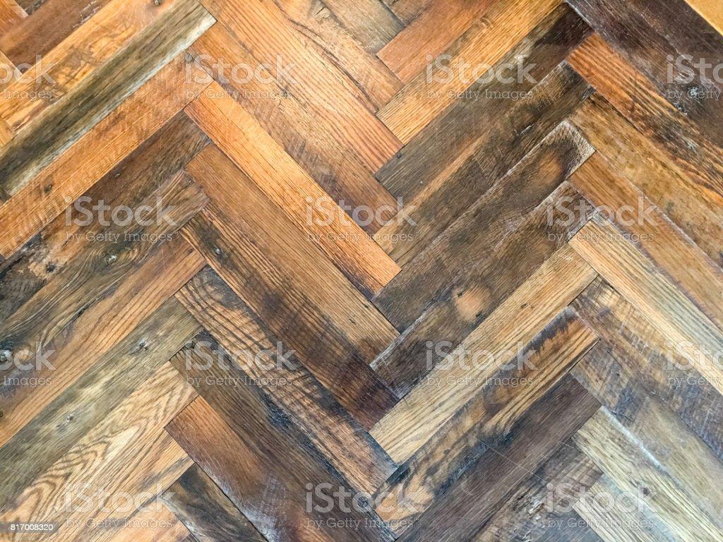 Close-up of herringbone pattern rustic hardwood floor stock photo