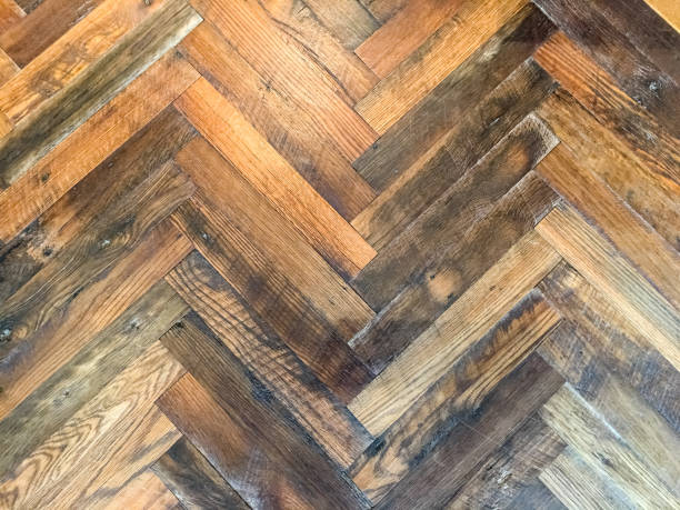 Close-up of herringbone pattern rustic hardwood floor stock photo