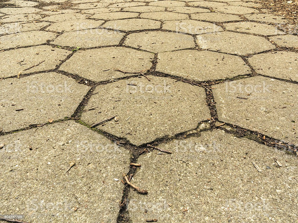 Primo piano di sfondo di texture pietra esagonale marciapiede