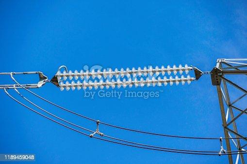 Close-up of high voltage power line insulation