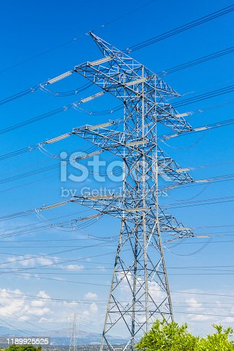 Close-up of high voltage power line tower with insulators