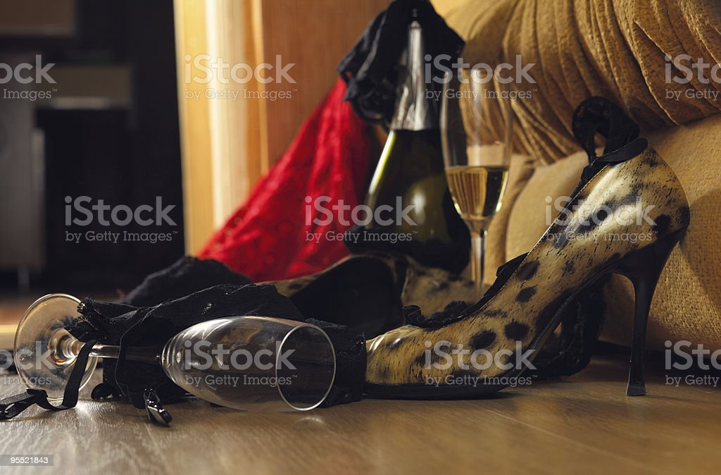 Close-up of high-heeled shoes, champagne and glasses royalty-free stock photo