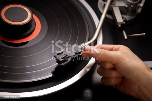 istock Close-up of holding a turntable arm 158228097