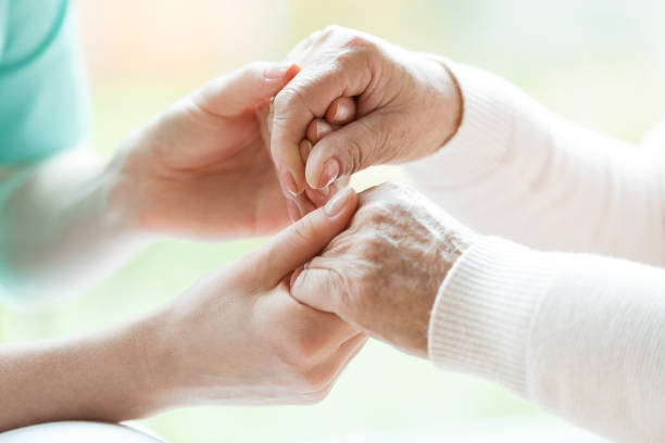 Close-up of holding hands stock photo