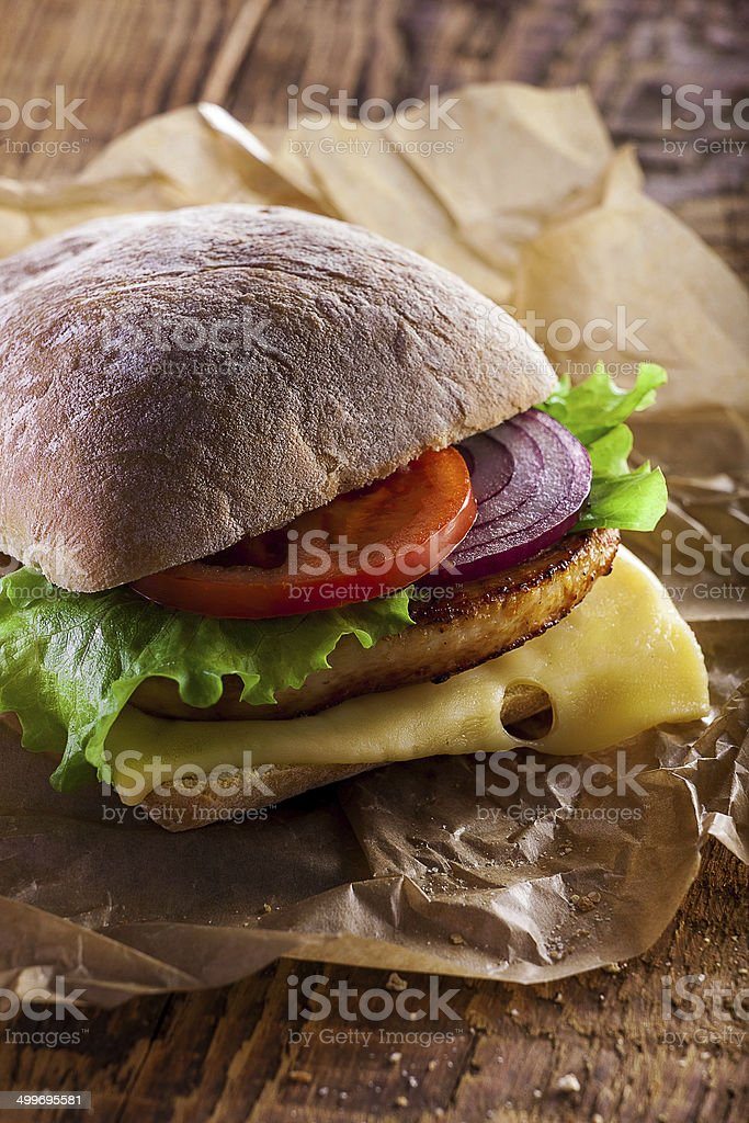 Closeup of home made burger on wooden background royalty-free stock photo