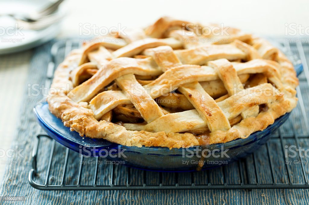 Close-up of homemade apple pie on cooling rack stock photo