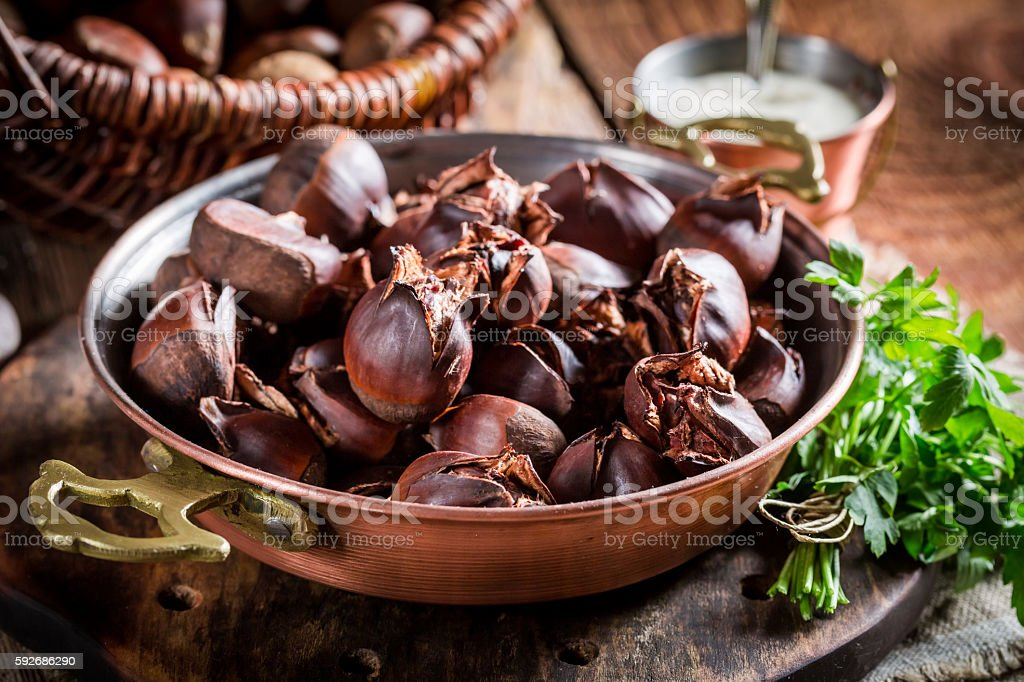 Closeup of homemade chestnuts with parsley stock photo