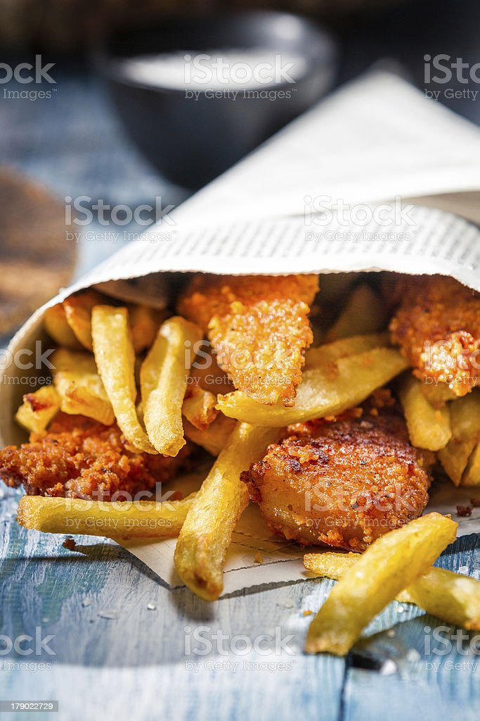 Close-up of homemade fish and chips wrapped with paper stock photo