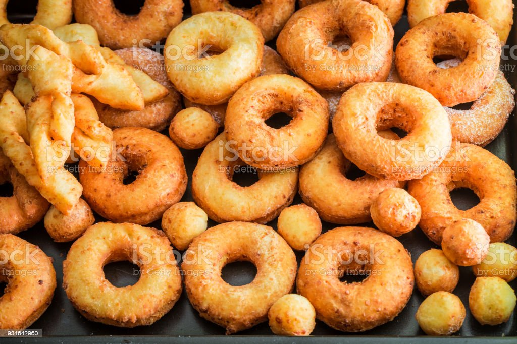 Closeup of homemade golden donuts freshly baked stock photo
