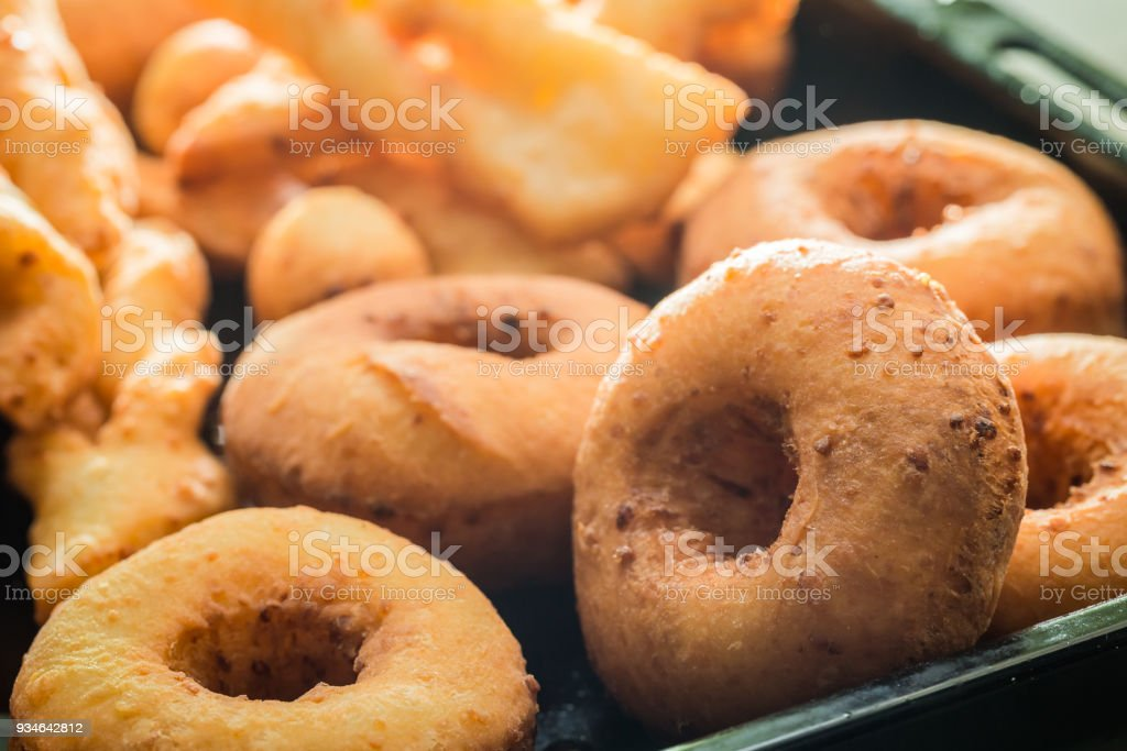 Closeup of homemade golden donuts with powdered sugar stock photo