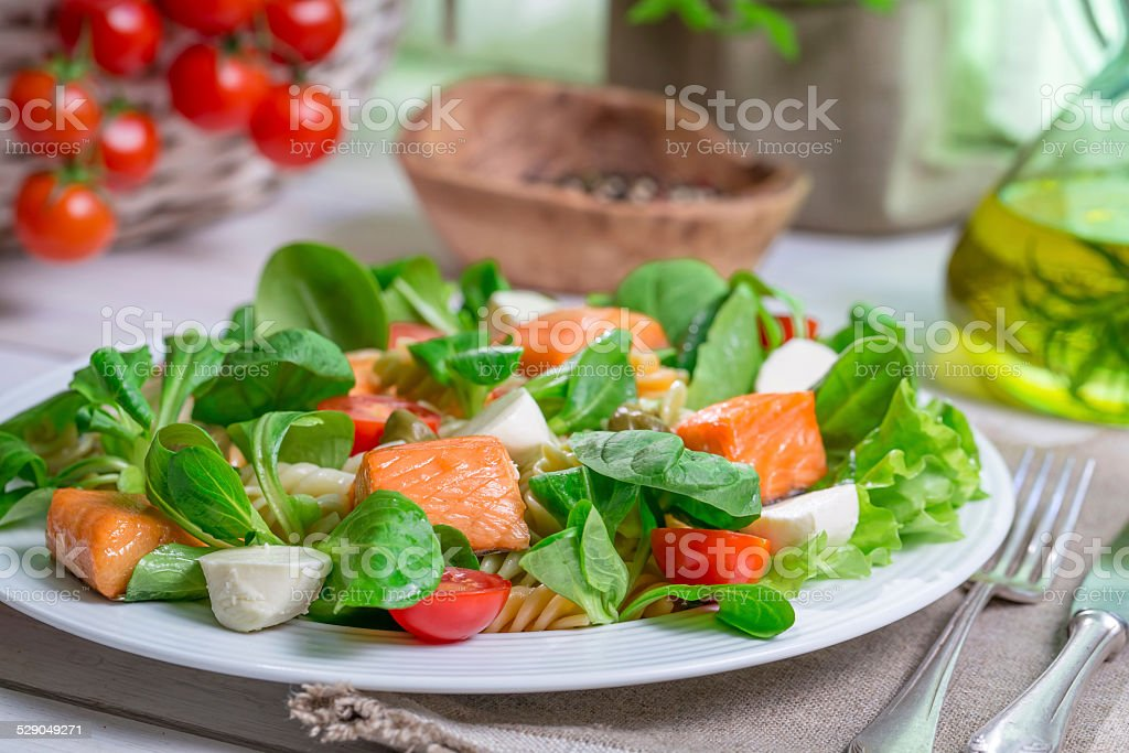 Closeup of homemade salad with salmon and vegetables stock photo