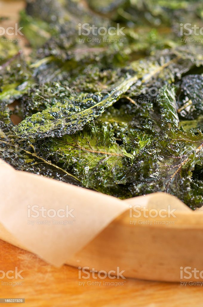 Close-up of Homemade Slow-Roasted Kale Chips stock photo