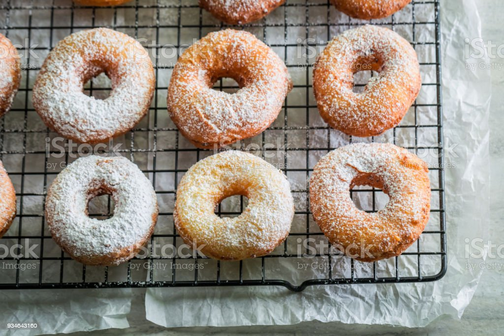 Closeup of homemade sweet donuts with powdered sugar stock photo