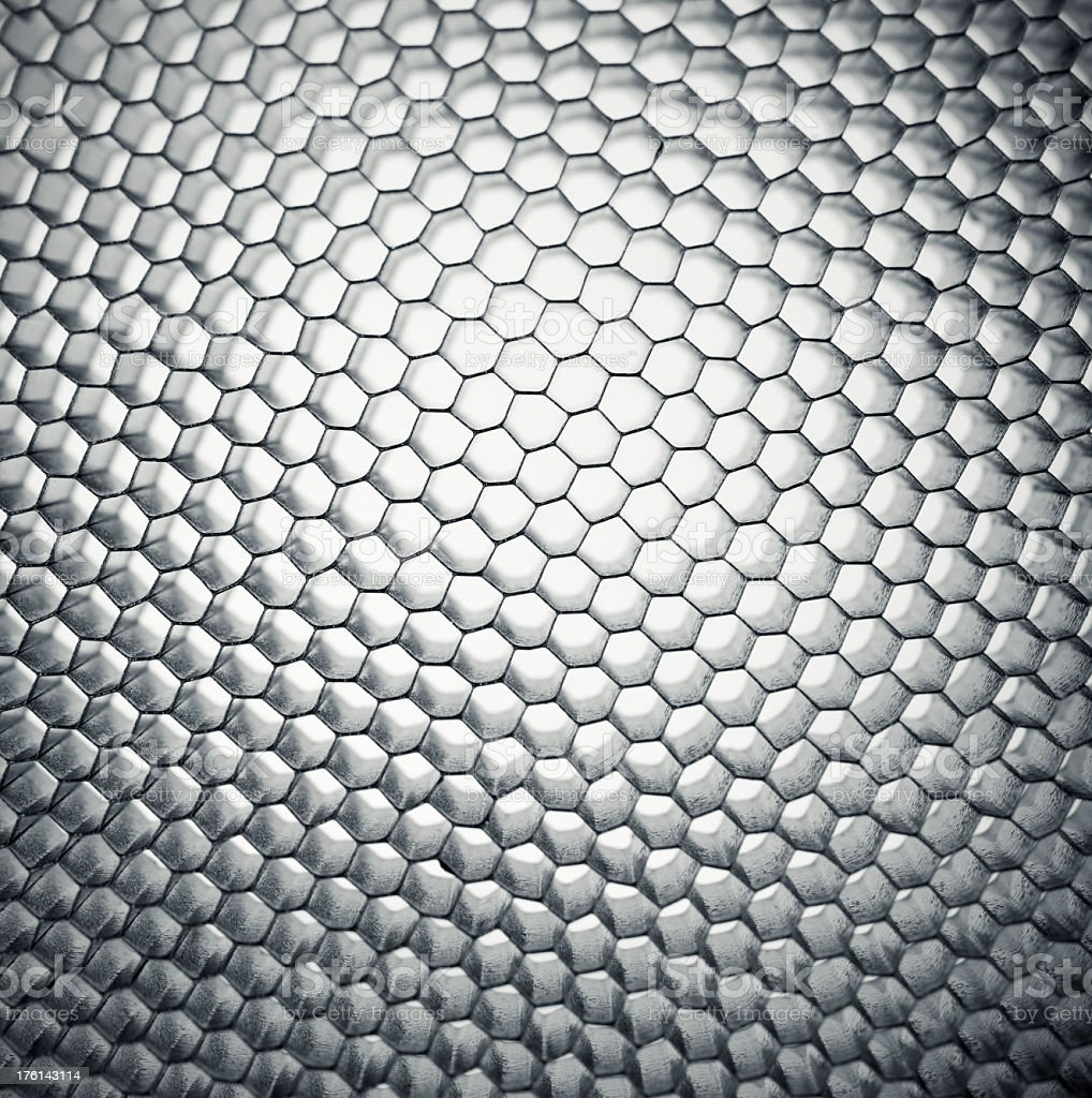 Close-up of honeycomb grid mesh background royalty-free stock photo
