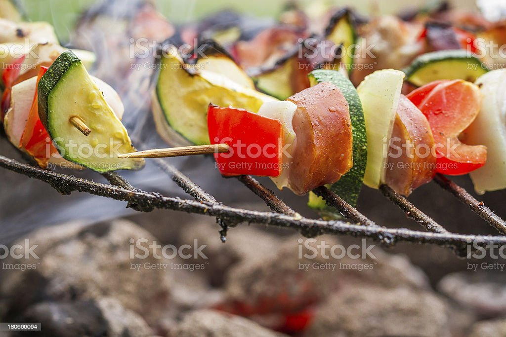 Closeup of hot skewers on the grill royalty-free stock photo