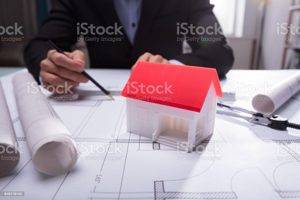 Close-up Of House Model On Blueprint stock photo