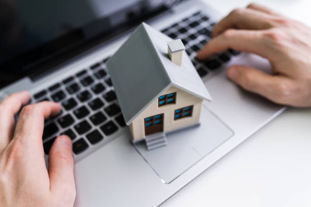 Close-up Of House Model Real Estate House Model Near Laptop On Desk auction stock pictures, royalty-free photos & images